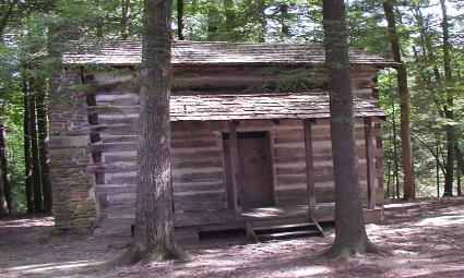 Rustic log cabin nestled among the trees in the Breaks Interstate Park.